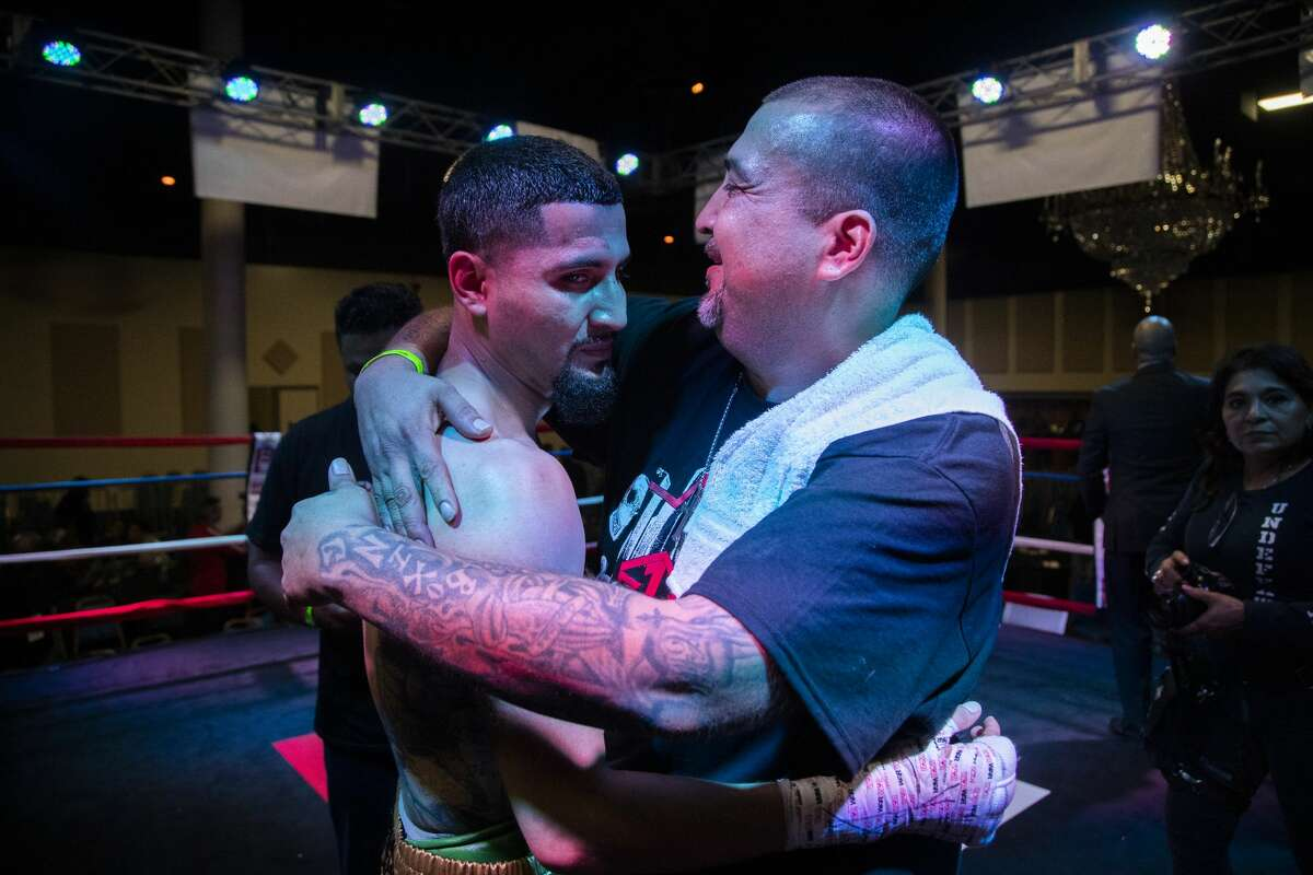 Joseph Rivera, 43, embraces his son Joseph Rivera, 22, after the fighter's boxing match against Ariel Vasquez at Houston's Arabia Shrine Center on Nov. 23, 2019,. It was a big moment for the Riveras' 713 Boxing Gym and came after a devastating month in which the club was broken into and valuable equipment and trophies stolen.