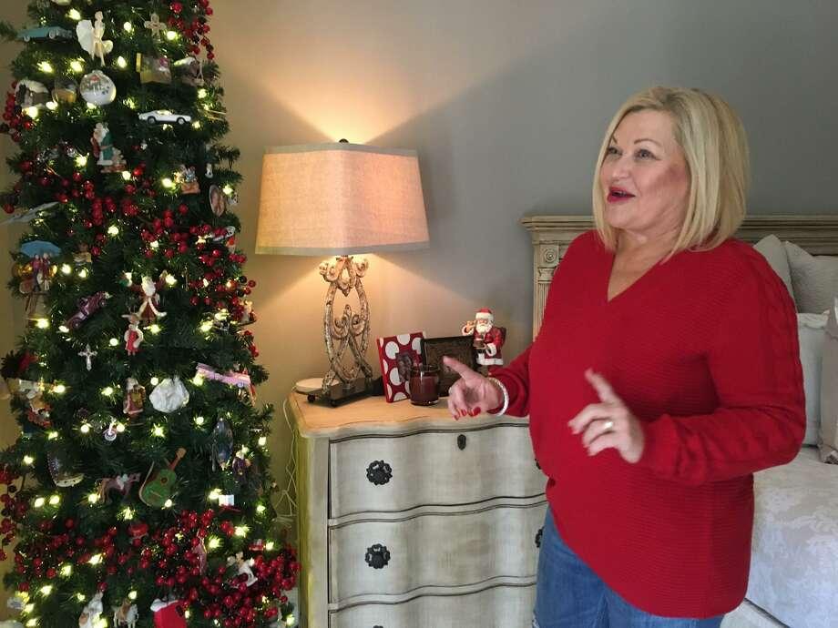 LindaEdmiaston shares a story about the ornaments on the Christmas tree at her Sugar Creek home. Photo: Karen Zurawski / Karen Zurawski