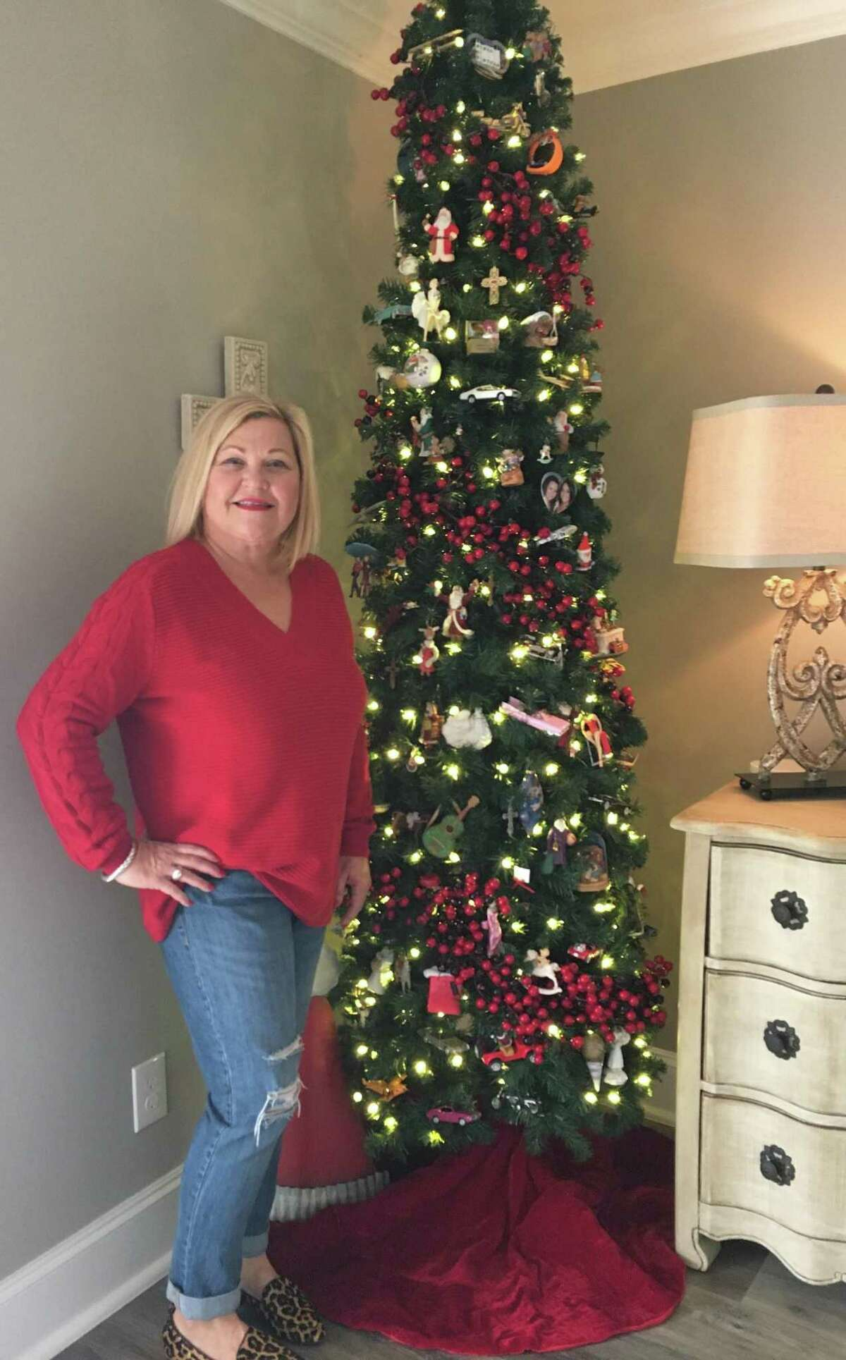 LindaEdmiaston placed this tree with ornaments of Santas, motorcycles and trucks in a second-floor bedroom of her Sugar Creek home. There are stories of family and friends associated with the ornaments.