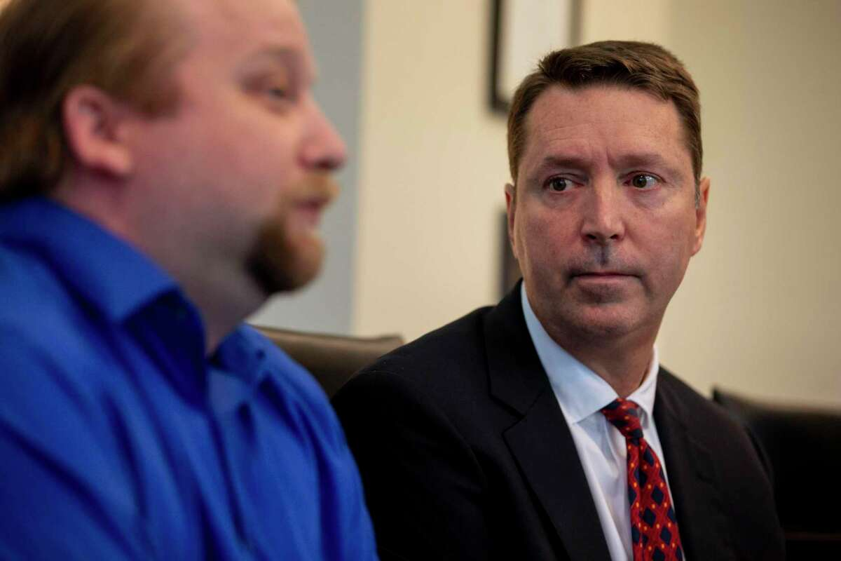 Attorney Thomas A. Crosley listens to Christopher Prescott speak about his son during a press conference held at Crosley Law Firm in San Antonio, Texas after a law suit was filed earlier that morning against the Bexar County Sheriff's Office on Dec. 2, 2019. Prescott's six-year-old son, Kameron Prescott, was shot and killed in his home when stray bullets from a deputy's gun hit him through the walls of their mobile home in 2017.