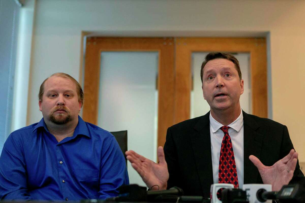"""Christopher Prescott, left, is the father of the boy slain by deputies in 2017. His lawyer, Tom Crosley, says the whole scenario was """"fraught with problems."""""""