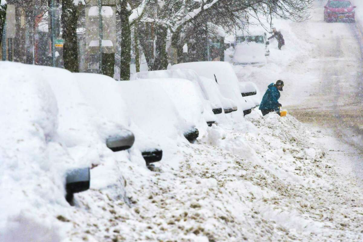 People begin the process of digging out vehicles from the snow piled up from plows on Monday, Dec. 2, 2019, in Albany, N.Y. (Paul Buckowski/Times Union)