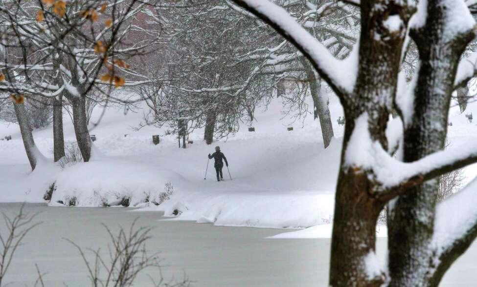 A skiers makes her way around Washington Park lake on Monday, Dec. 2, 2019, in Albany, N.Y. (Paul Buckowski/Times Union)