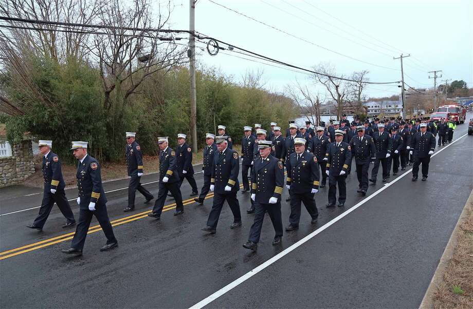 Westport firefighters march up Riverside Avenue to the memorial service for Turker Aksoy at Saugatuck Elementary School on Dec. 1, 2019, in Westport. Photo: Jarret Liotta / For Hearst Connecticut Media / Jarret Liotta / ©Jarret Liotta