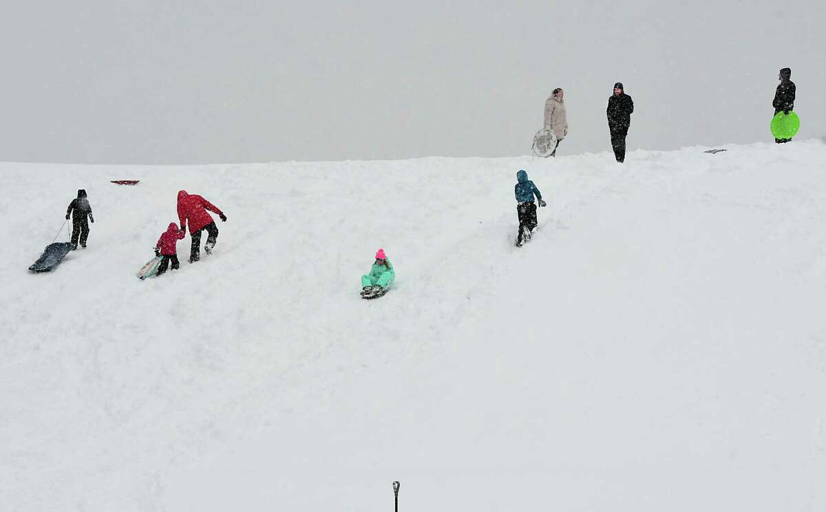 Families are seen sledding on a hill in Frear Park during a major snow storm on Monday, Nov. 2, 2019 in Troy, N.Y. The local schools had a snow day because of the snow.(Lori Van Buren/Times Union)