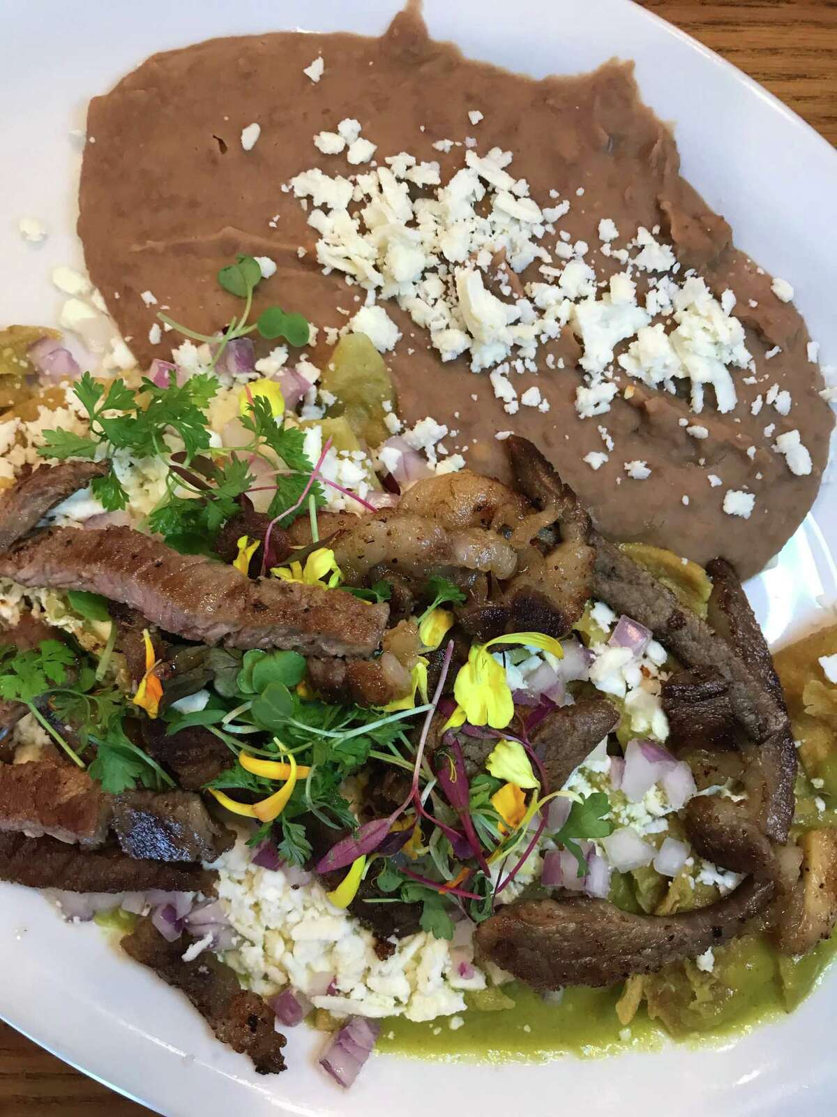 The Chilaquiles Tehuacan at Marla Restaurant is topped with grilled rib-eye.