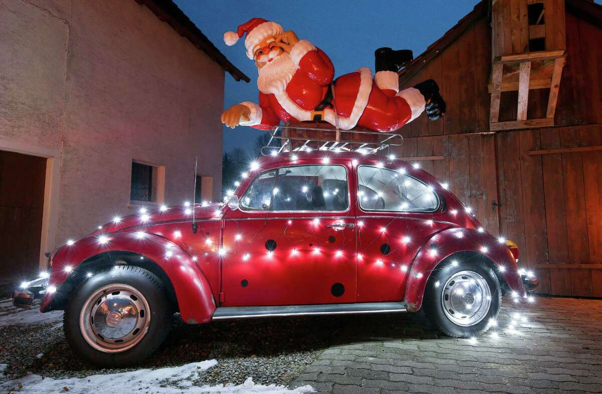 Here comes Santa Claus on a VW Bug. If you, too, use your ride to express your holiday spirit, or deck the walls of your cubicle at work, we want to see the photos.