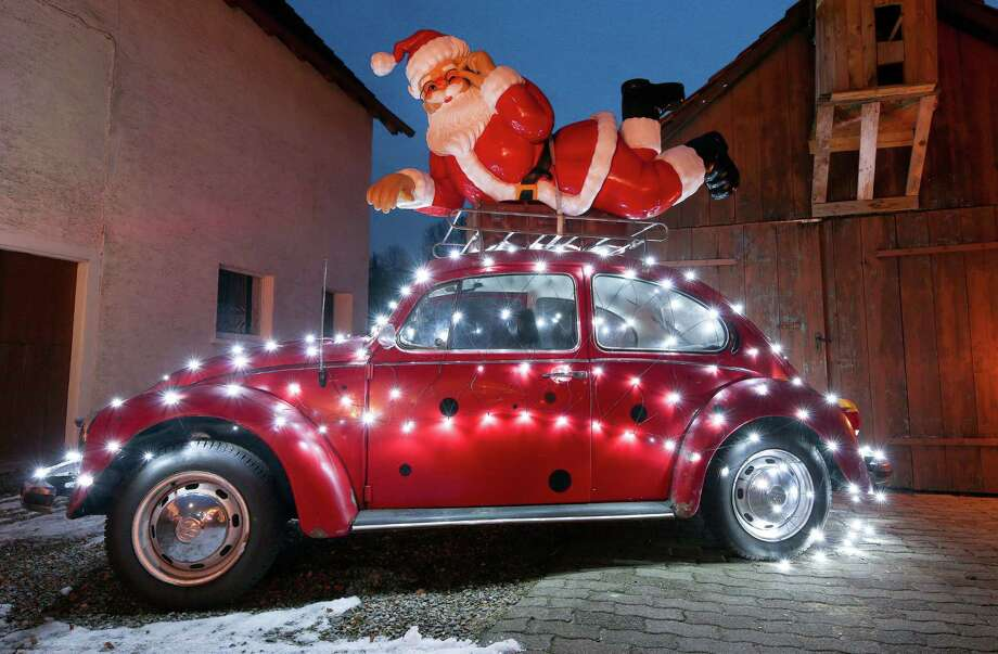 Here comes Santa Claus on a VW Bug. If you, too, use your ride to express your holiday spirit, or deck the walls of your cubicle at work, we want to see the photos. Photo: Thomas Warnack /DPA /AFP Via Getty Images / DPA