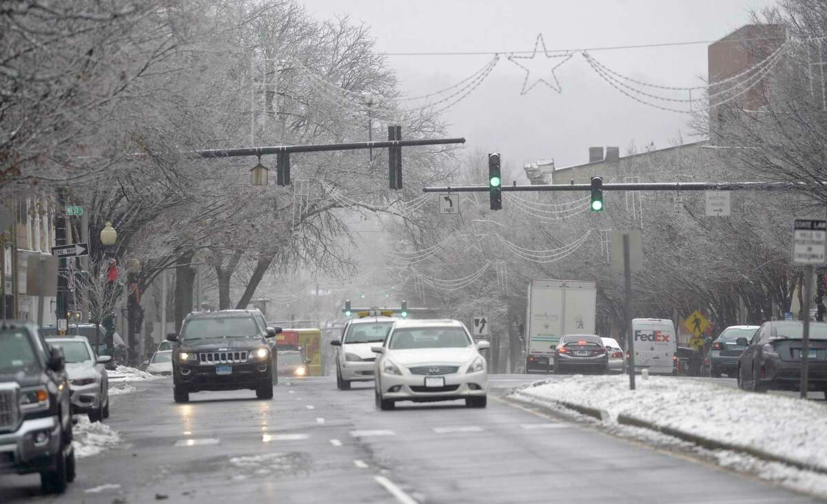 Traffic on Main Street in Danbury, Conn, during snow storm on Monday, December 2, 2019,