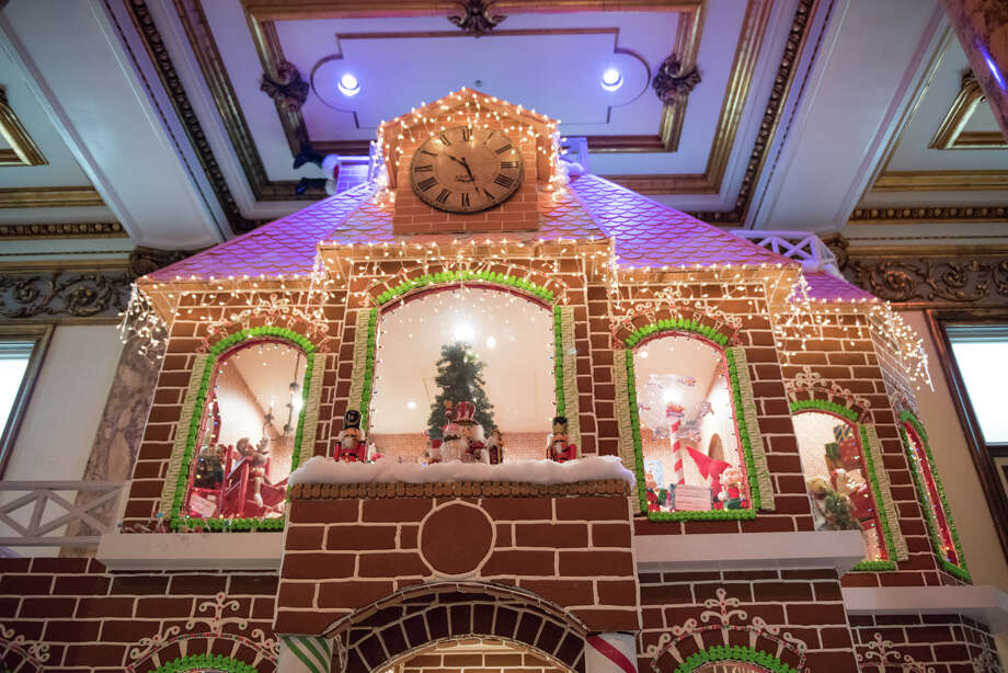 A look behind the scenes of the making of the two-story, life-sized gingerbread house in the Fairmont hotel. Photo: Blair Heagerty / SFGate