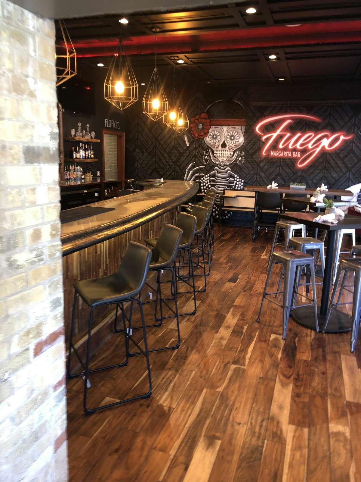 Fuego Margarita Bar 1170E.Commerce St. (next to Smoke BBQ Restaurant) Fuego is aDíadelosMuertos-inspiredspace serving a