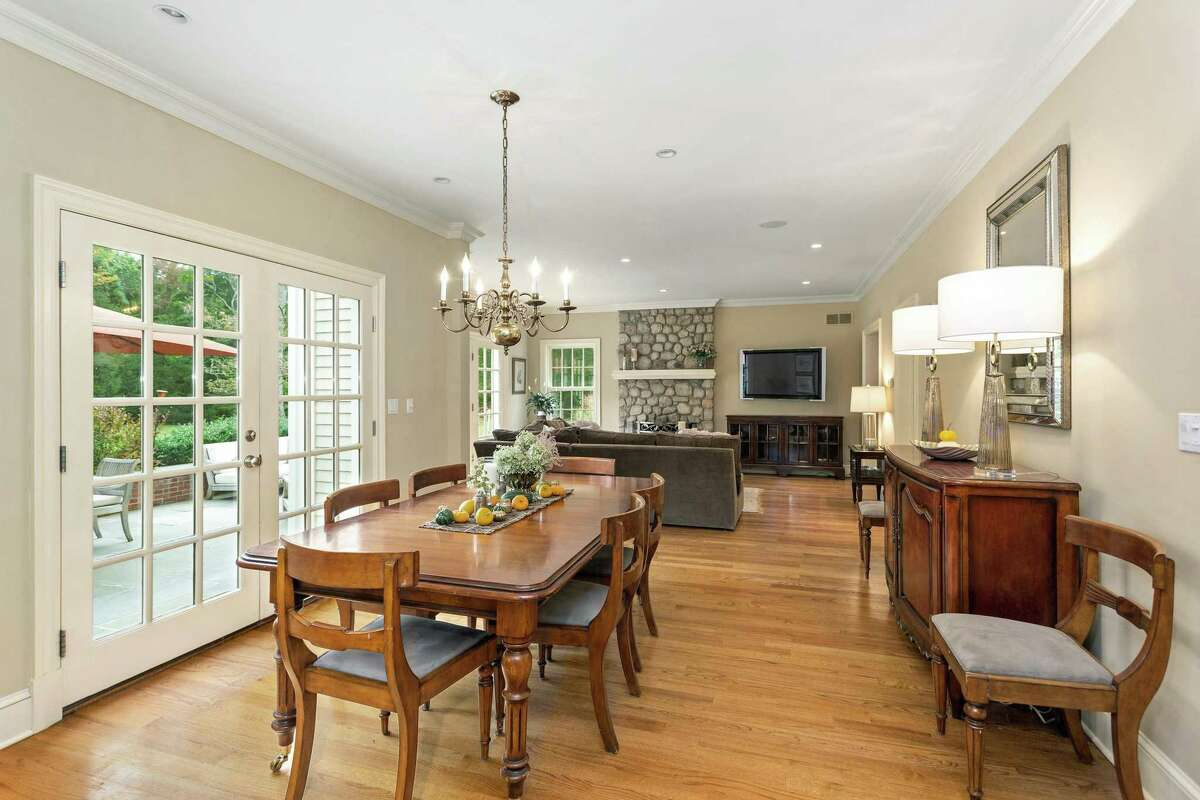 The eat-in section of the kitchen has French doors to the bluestone patio and backyard.