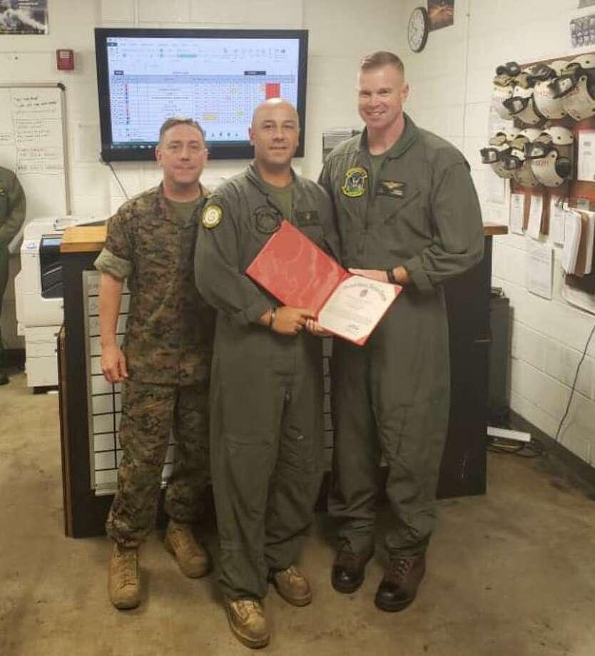 (Left to right): Sergeant Major Andrew R. Klatt (HMH-464 Sergeant Major); Sergeant Daniel Nieves; Lieutenant Colonel Thomas N. Trimble (HMH-464 Commanding Officer) Photo: Contributed
