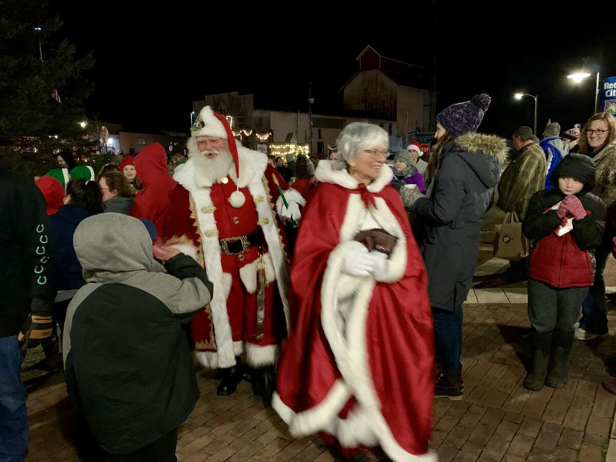Crowds braved the bitter cold to enjoy the first ever Reed City Evergreen Festival lighted parade on Friday, Nov. 29. The festival included visits with Santa, cookie decorating, a poster contest and storefront decorations.
