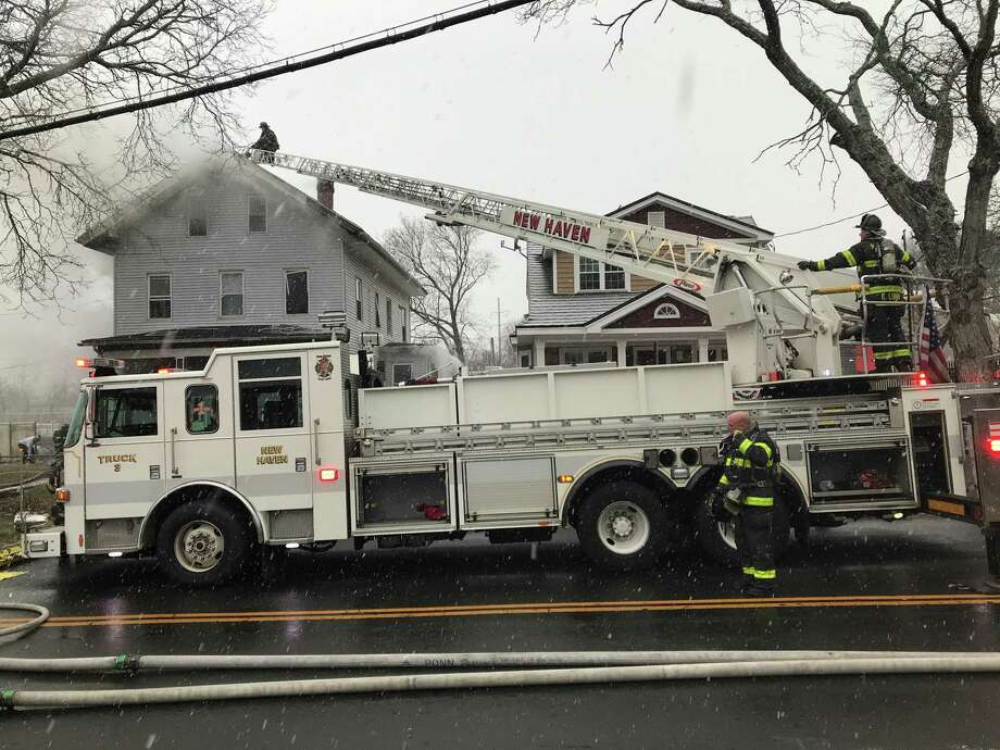 Ten people were displaced and six injured in a two alarm fire on Quinnipiac Avenue Sunday. Photo: Brad Young