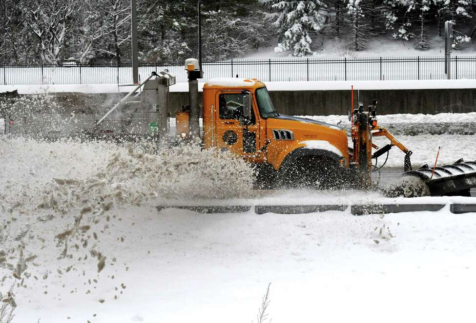New York State Department of Transportation crews clear snow from I-787 southbound lanes across from Jennings Landing on Monday, Dec. 2, 2019, in Albany, N.Y. (Will Waldron/Times Union)
