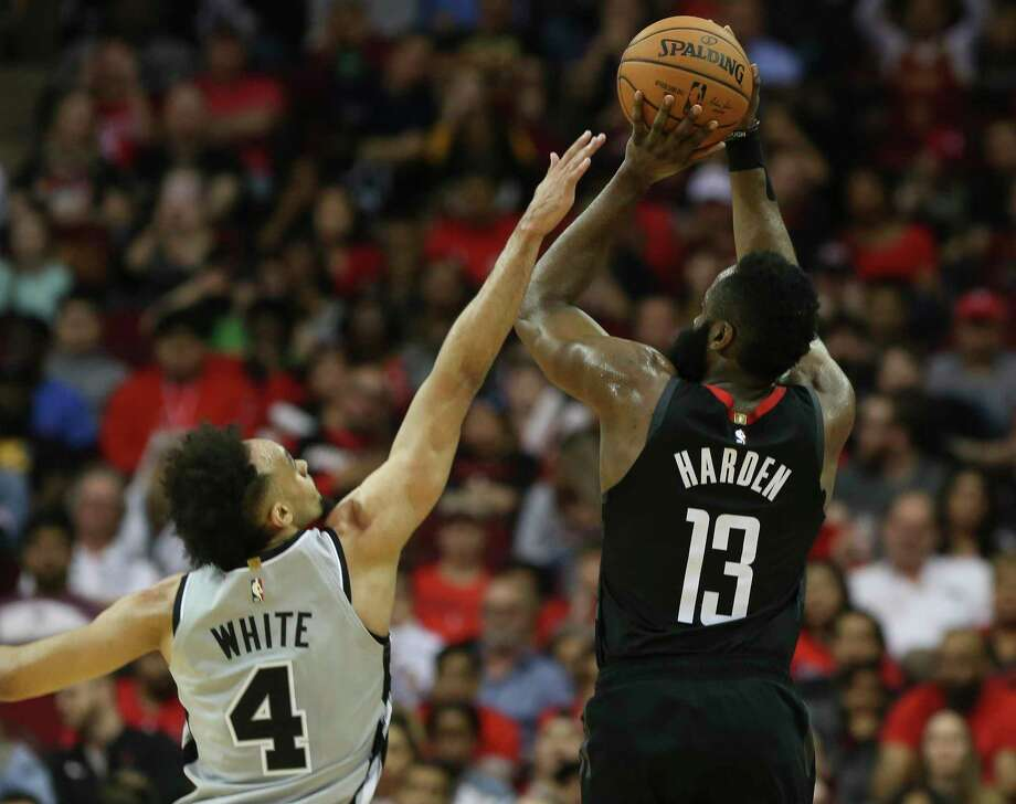 Houston Rockets guard James Harden (13) shoots a three point basket while San Antonio Spurs guard Derrick White (4) is trying to stop him during the third quarter of the NBA game at Toyota Center on Friday, March 22, 2019, in Houston. The Houston Rockets defeated the San Antonio Spurs 111-105. Photo: Yi-Chin Lee, Staff / Staff Photographer / © 2019 Houston Chronicle