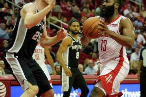 Houston Rockets James Harden moves to the basket past San Antonio Spurs Jakob Poeltl during the second half of NBA game at Toyota Center Wednesday, Oct. 16, 2019, in Houston.