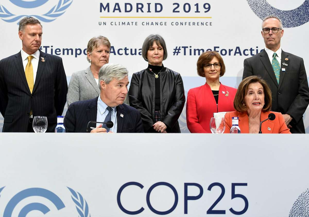 US House Speaker Nancy Pelosi (R) and US Senator Sheldon Whitehouse (D-RI) give a press conference during the UN Climate Change Conference COP25 at the 'IFEMA - Feria de Madrid' exhibition centre, in Madrid, on December 2, 2019. - Spain's Socialist government offered to host this year's UN climate conference, known as COP25, from December 2 to December 13, 2019, after the event's original host Chile withdrew last month due to deadly riots over economic inequality. (Photo by PIERRE-PHILIPPE MARCOU / AFP) (Photo by PIERRE-PHILIPPE MARCOU/AFP via Getty Images)