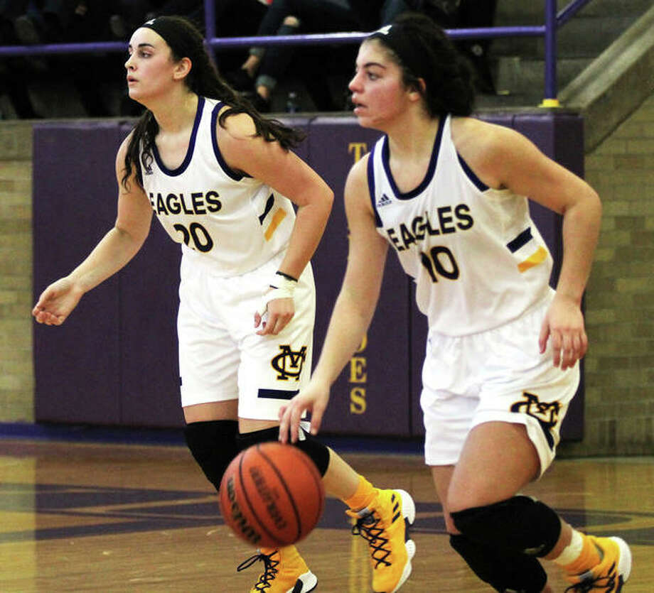 CM's Kourtland Tyus (right) and Anna Hall bring the ball upcourt in a game last season at the Taylorville Tournament. Now back for their senior season, Tyus and Hall get their last shot at an elusive state tourney trip for the Eagles. Photo: Greg Shashack / The Telegraph