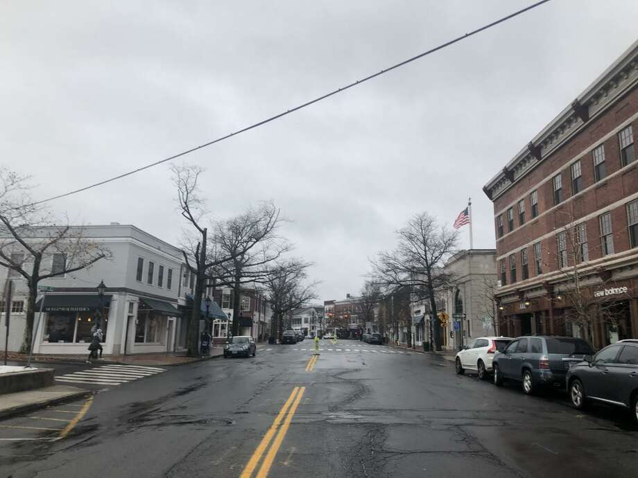 Main Street in New Canaan is cleansed by rain on a rainy day. Photo: Contributed Photo