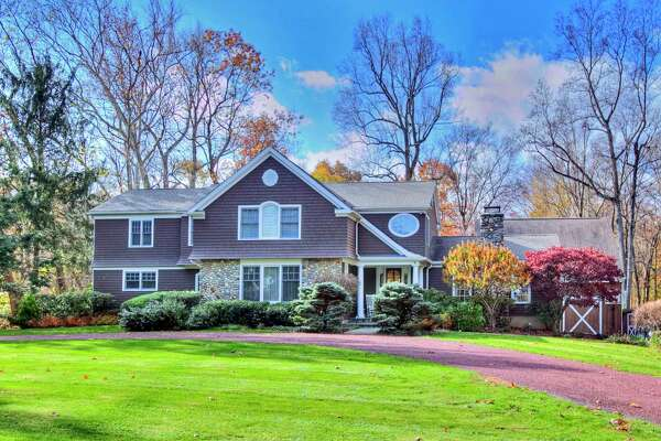 The riverfront custom colonial house at 30 West Branch Road has scenic panoramic views of and access to the Saugatuck River's west branch.