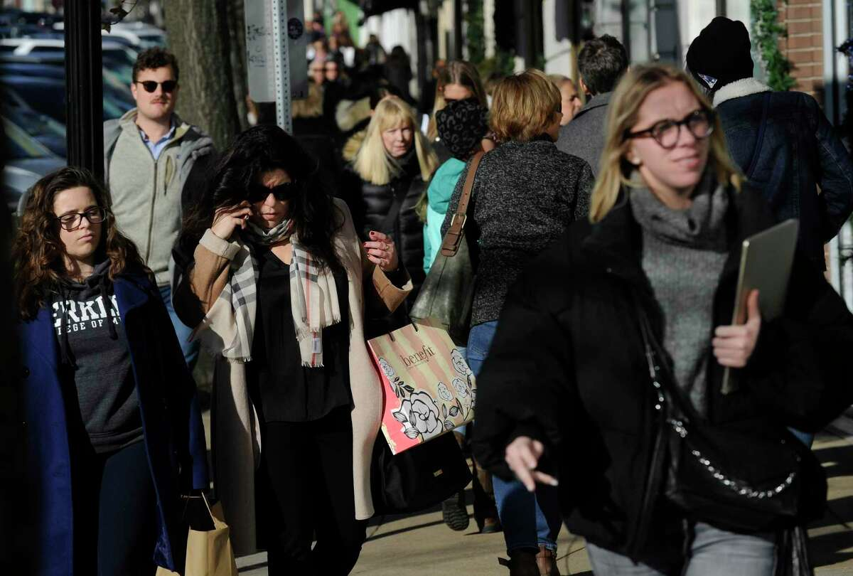 Holiday shoppers stroll up and down Greenwich Avenue looking for Black Friday sales from local merchants in Greenwich, Conn. on Nov. 29, 2019.