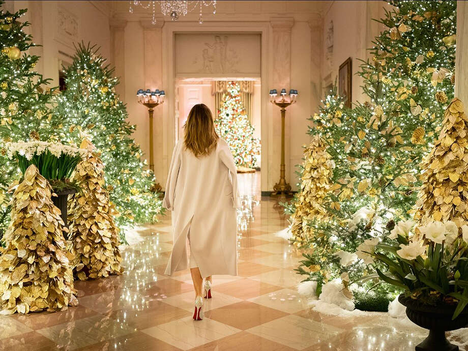 First lady Melania Trump previewed the White House Christmas decorations wearing her signature look: a coat draped over her shoulder. Photo: Official White House Photo By Andrea Hanks / White House