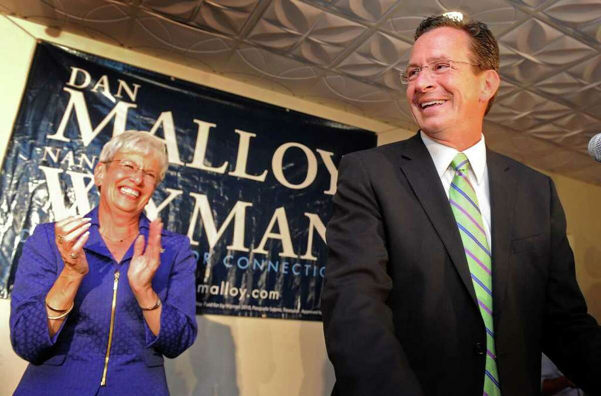Former Stamford Mayor Dan Malloy and running mate Nancy Wyman celebrate their victory in the Democratic gubernatorial primary Tuesday August 10, 2010 at City Steam Brewery Cafe in Hartford.