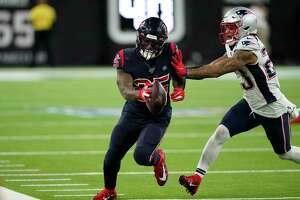 Houston Texans running back Duke Johnson (25) is pushed out of bounds by New England Patriots strong safety Patrick Chung (23) during the second half of an NFL football game Sunday, Dec. 1, 2019, in Houston. (AP Photo/David J. Phillip)
