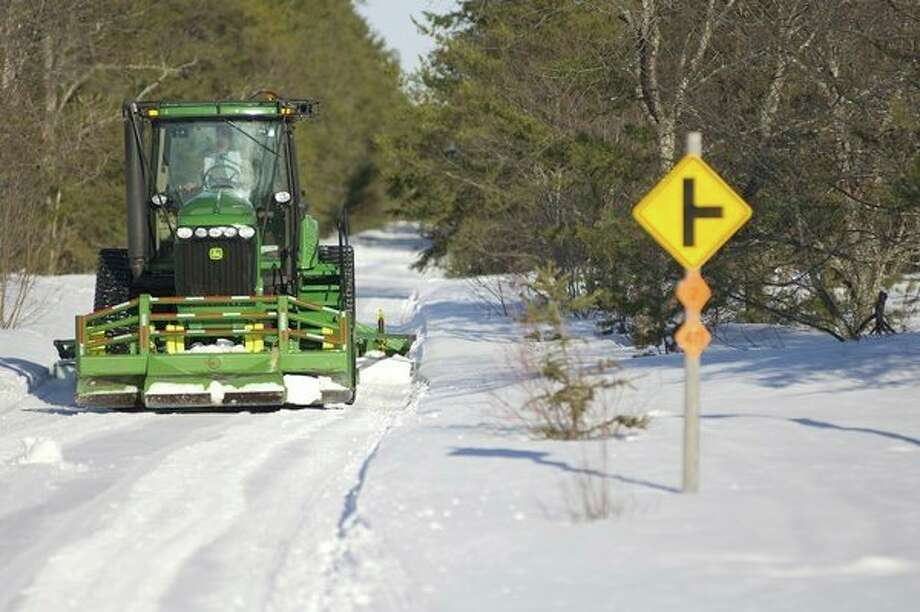 A trail groomer clear off a snowy snowmobile trail.People interested in helping to shape and support Michigan's snowmobile program and trail opportunities are encouraged to apply for vacancies on Michigan's Snowmobile Advisory Workgroup.(Courtesy photo/Michigan DNR) / Copyright 2008 State of Michigan