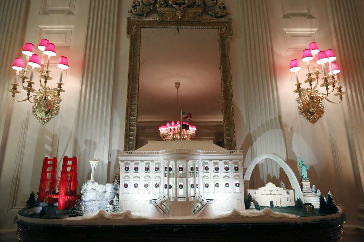 WASHINGTON, DC - DECEMBER 02: A miniature Golden Gate Bridge and St. Louis Gateway Arch stand next to a Ginger Bread White House in the State Dining Room at the White House December 2, 2019 in Washington, DC. The White House expects to host 100 open houses and more than 30,000 guests who will tour the topiary trees, architectural models of major U.S. cities, the Gold Star family tree and national monuments in gingerbread. (Photo by Mark Wilson/Getty Images)