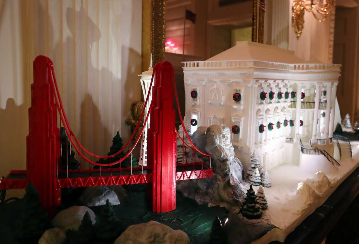 WASHINGTON, DC - DECEMBER 02: A miniture Golden Gate Bridge stands next to a Ginger Bread White House in the State Dining Room at the White House December 2, 2019 in Washington, DC. The White House expects to host 100 open houses and more than 30,000 guests who will tour the topiary trees, architectural models of major U.S. cities, the Gold Star family tree and national monuments in gingerbread. (Photo by Mark Wilson/Getty Images)
