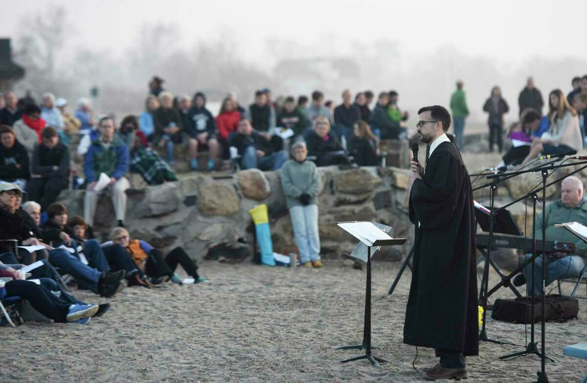 The Rev. Patrick Collins leads a prayer at First Congregational Church of Greenwich's Easter Sunrise Beach Service at Greenwich Point Park in 2017. It was announced Dec. 1 that the Rev. Patrick Collins, who has served as Associate Pastor since September 2016, will be the new Senior Pastor at FCCOG.