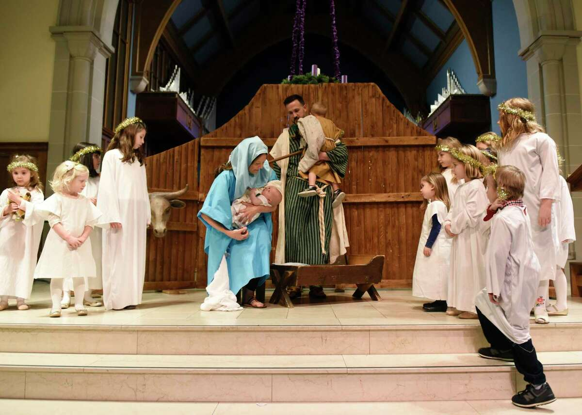The Rev. Patrick Collins, his wife Kate, and children Jonah and Norah portray Joseph, Mary, Jesus and a shepherd as children, dressed as angels, surround them during a live nativity re-enactment at the Children's Christmas Eve Service at First Congregational Church of Greenwich on Christmas Eve of 2018. It was announced Dec. 1 that the Rev. Patrick Collins, who has served as Associate Pastor since September 2016, will be the new Senior Pastor at FCCOG.