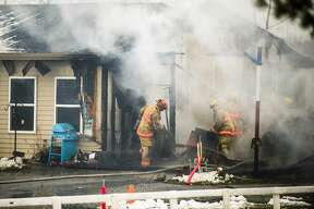 Firefighters from Midland, Homer and Lee Townships work to extinguish a fire at 2231 E. Freeland Road Monday, Dec. 2, 2019 in Ingersoll Township. (Katy Kildee/kkildee@mdn.net)