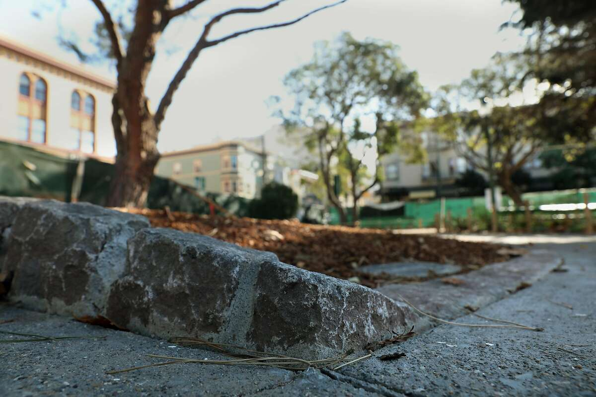 Cobblestones made and reused line the gardens at Washington Square Park as curbs and bands seen on Friday, Nov. 29, 2019, in San Francisco, Calif.