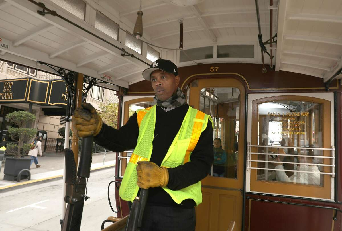 Reigning cable car bell ringing champion Byron Cobb seen working the California cable car line on Tuesday, Nov. 26, 2019, in San Francisco, Calif.