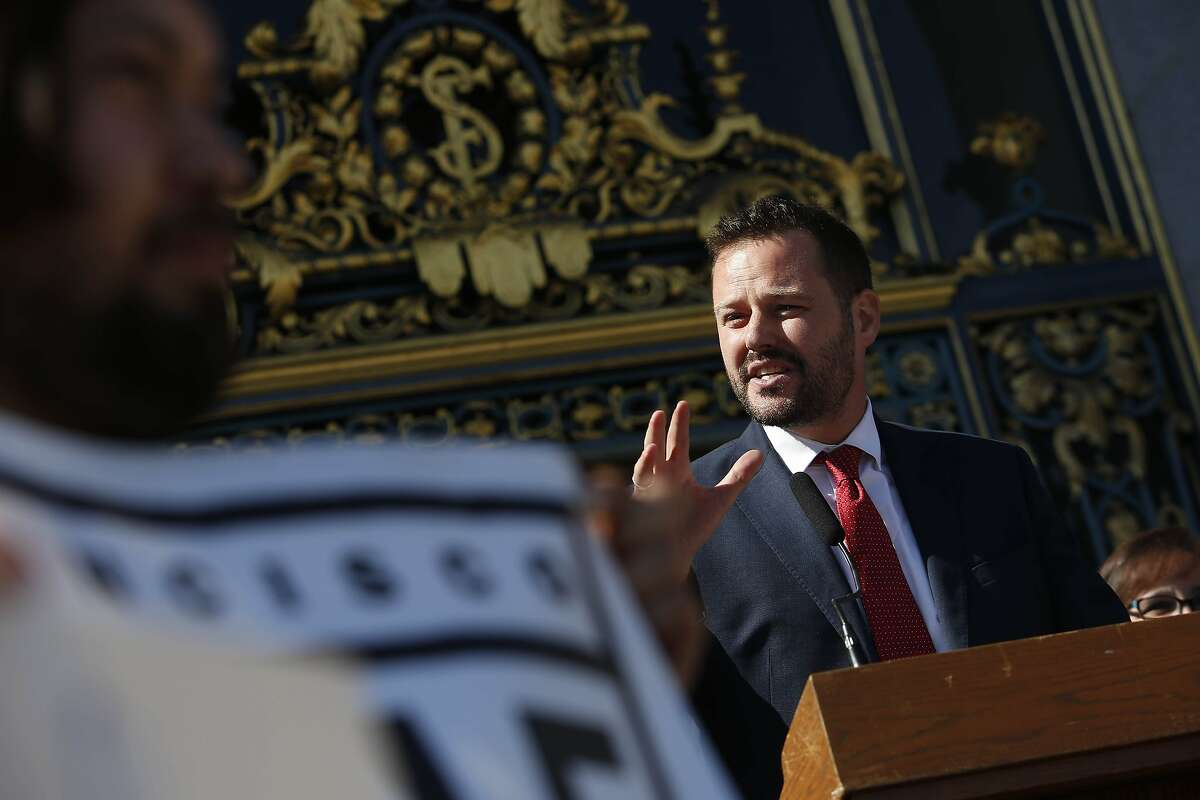 Supervisor Matt Haney (at podium) speaks on the steps of City Hall during a rally supporting Better Market Street on Tuesday, October 15, 2019 in San Francisco, Calif.