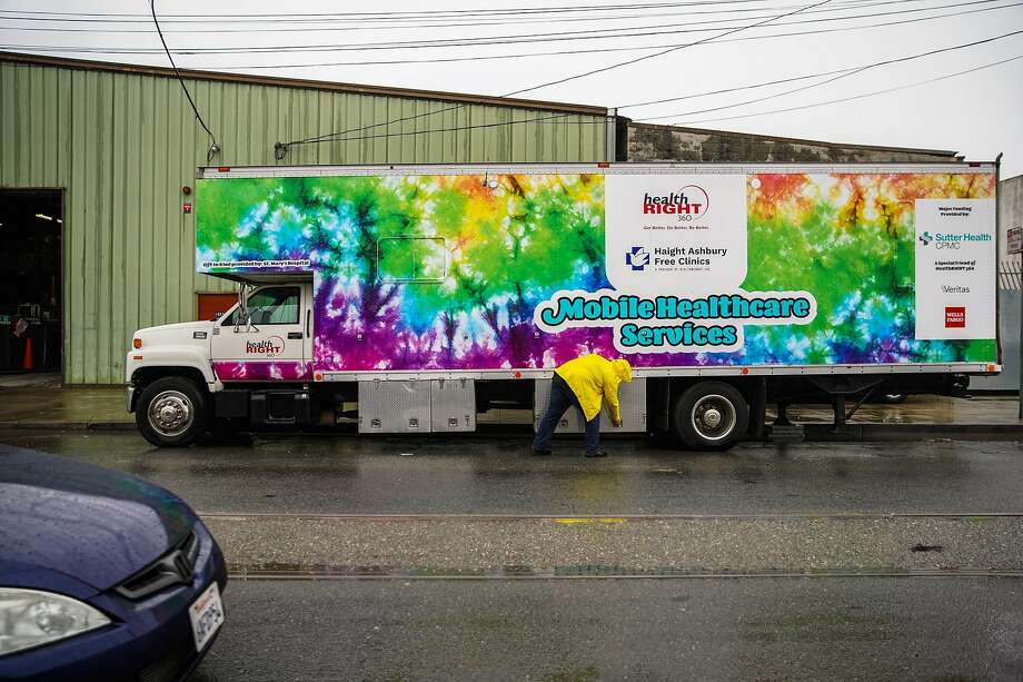 Jason Gibson of HealthRight 360 closes down the organization's mobile van. Photo: Gabrielle Lurie / The Chronicle