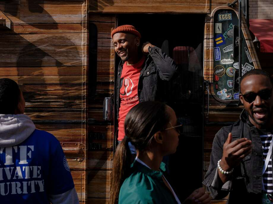 Rashad Armstead, a chef and the founder of the Black Food Collective, a consortium of food trucks in Oakland. Below: AfroTech conference attendees sample their fare from a truck in Oakland. Photo: Photos By Ulysses Ortega / New York Times
