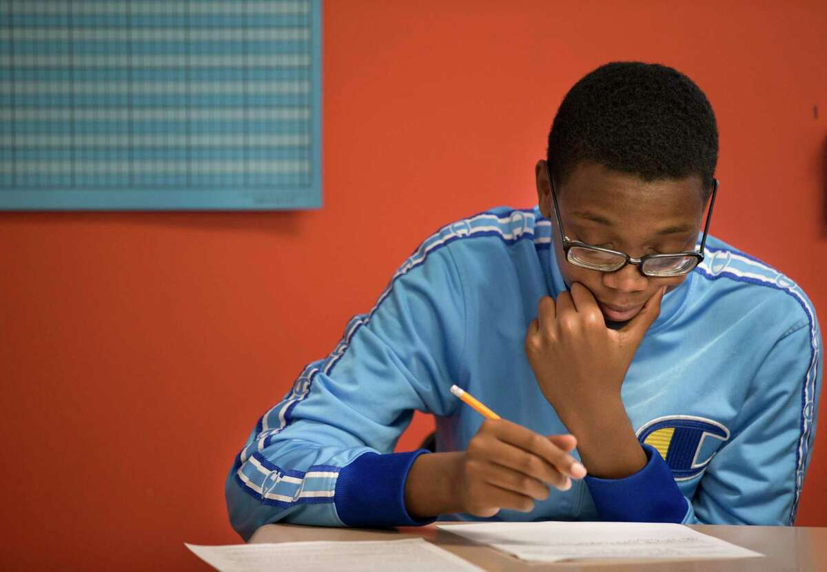 Worthing High School student Darnell Leggett works during a Miles Ahead Scholars English class on Tuesday, Oct. 29, 2019, in Houston. The program, which was piloted by state Sen. Borris Miles at the urging of Lt. Gov. Dan Patrick, identifies high-potential freshmen and sophomore male students at three HISD high school and aims to get them enrolled in the nation's most prestigious universities.