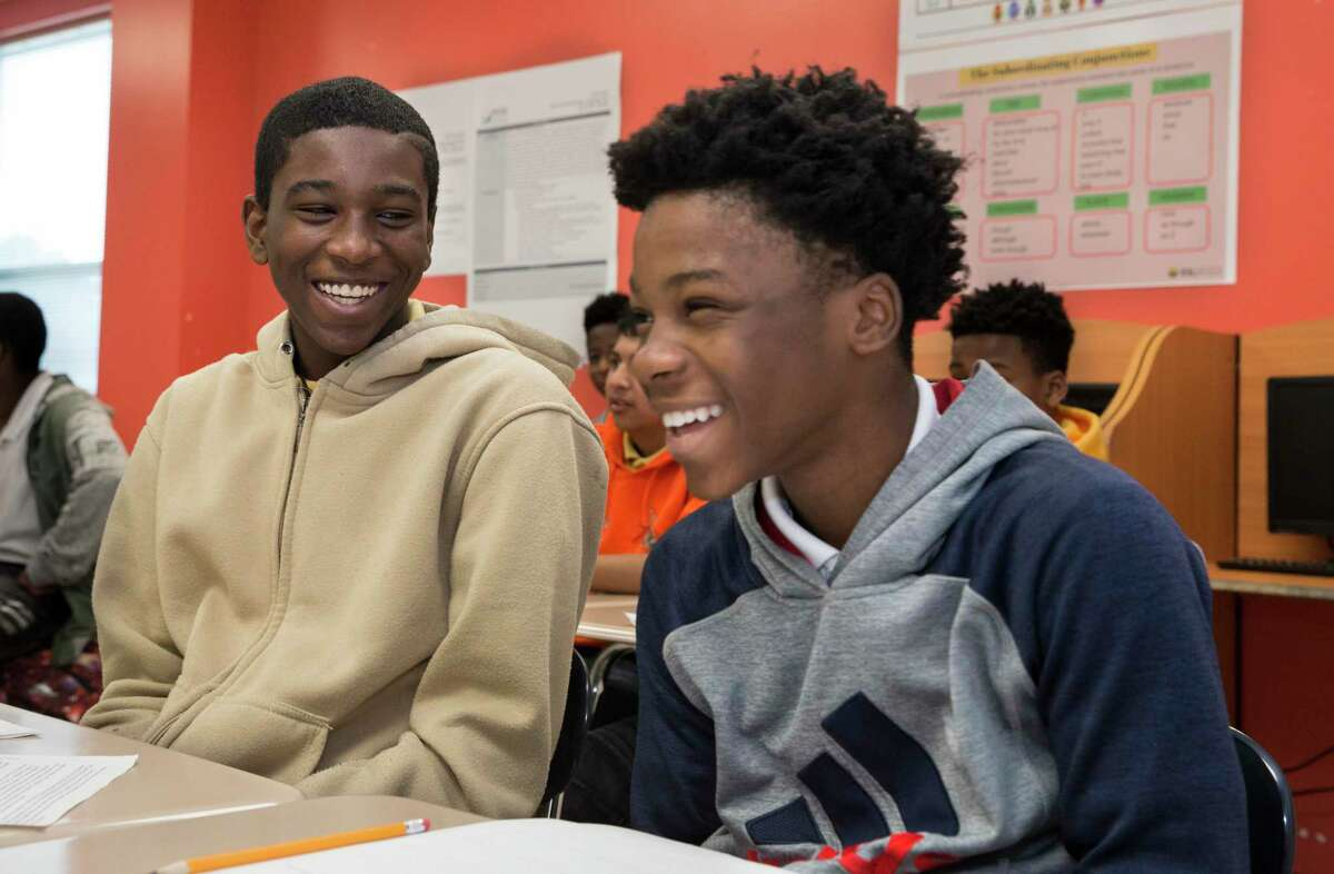 Worthing High School students Dynell Patrick, left, and Cordarius Buck share a laugh while talking about imaginary scenarios during a Miles Ahead Scholars English class exercise to understand identity on Tuesday, Oct. 29, 2019, in Houston. The program, which was piloted by state Sen. Borris Miles at the urging of Lt. Gov. Dan Patrick, identifies high-potential freshmen and sophomore male students at three HISD high school and aims to get them enrolled in the nation's most prestigious universities.