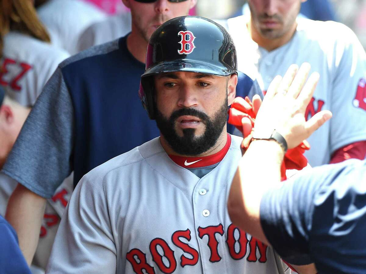 ANAHEIM, CA - JULY 23: Sandy Leon #3 of the Boston Red Sox is greeted in the dugout after scoring a run on a single by Deven Marrero #17 in the fifth inning against the Los Angeles Angels of Anaheim at Angel Stadium of Anaheim on July 23, 2017 in Anaheim, California. (Photo by Jayne Kamin-Oncea/Getty Images) ORG XMIT: 700011729