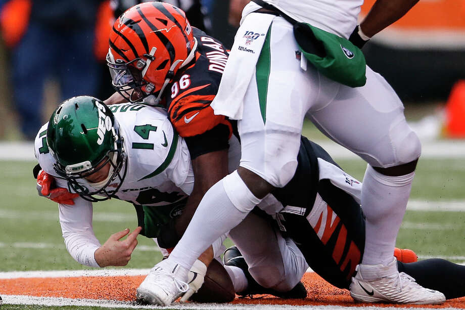 New York Jets quarterback Sam Darnold (14) is sacked by Cincinnati Bengals defensive end Carlos Dunlap (96) during the second half of an NFL football game, Sunday, Dec. 1, 2019, in Cincinnati. (AP Photo/Gary Landers) Photo: Gary Landers / Copyright 2019 The Associated Press. All rights reserved.