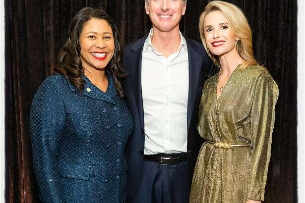 Mayor London Breed (left) with Gov. Gavin Newsom and his wife, Jennifer Siebel Newsom at the Flip the Script Gala. Nov. 13, 2019.