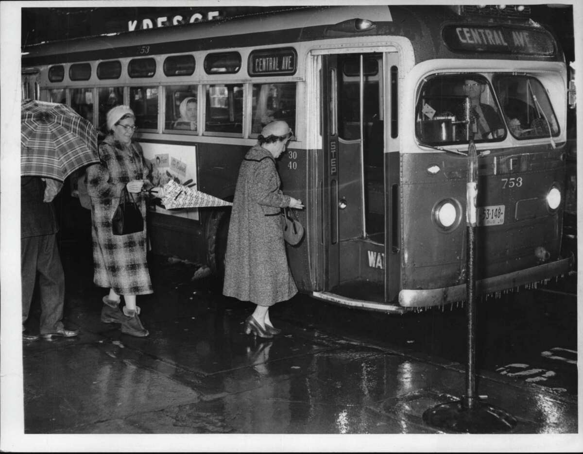 Passengers board transit bus at State & Pearl, Albany, New York. December 29, 1959 (Times Union Archive)
