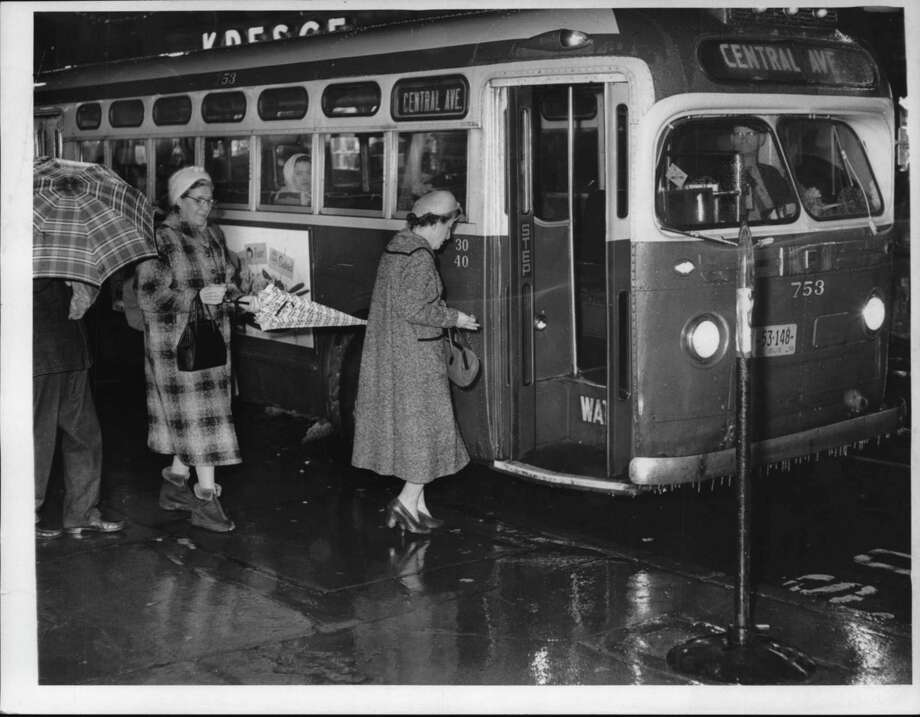 Passengers board transit bus at State & Pearl, Albany, New York. December 29, 1959 (Times Union Archive) / Times Union