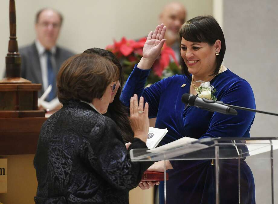 Newly elected City Councilwoman Maria Pereira is sworn in by ex-judge Carmen Lopez during the swearing in ceremony of city officials at City Hall in Bridgeport, Conn. on Thursday, November 28, 2019. Photo: Brian A. Pounds / Hearst Connecticut Media / Connecticut Post