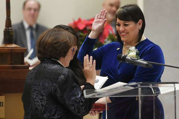 Newly elected City Councilwoman Maria Pereira is sworn in by ex-judge Carmen Lopez during the swearing in ceremony of city officials at City Hall in Bridgeport, Conn. on Thursday, November 28, 2019.